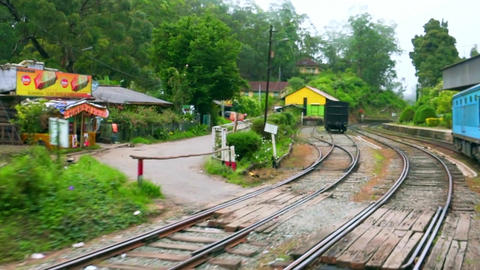 The train passes by the railway station in rural Sri Lanka Footage