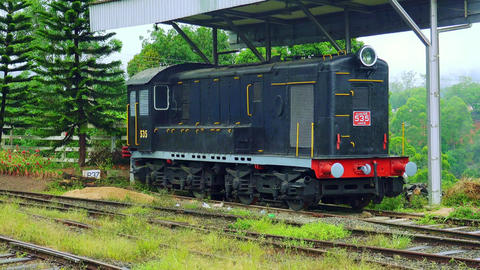 Old fashioned locomotive on railway station in rural Sri Lanka Footage