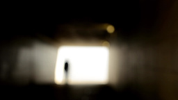 Light at end of tunnel - man walks - blurred shot Footage