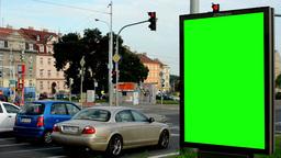 billboard in the city near road and buildings - green screen - people with cars Footage