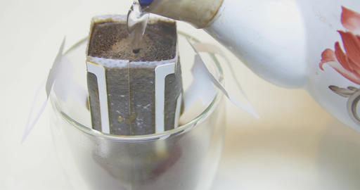Pouring hot water into bag of coffee Footage