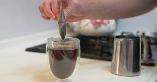 Pouring milk into drip coffee ビデオ