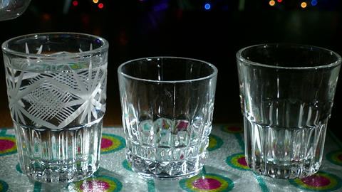 Three Glasses Of Vodka Poured Slowlly stock footage