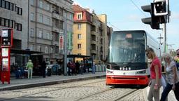 city: urban street - passing tram - cars - buildings - tram stop Footage