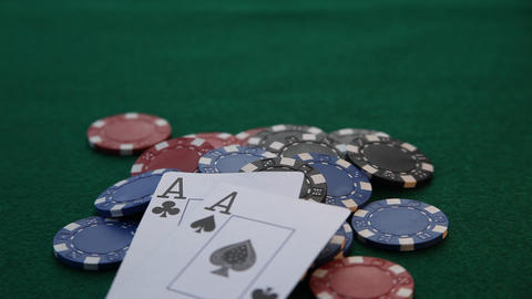 Two aces placed on pile of chips Footage