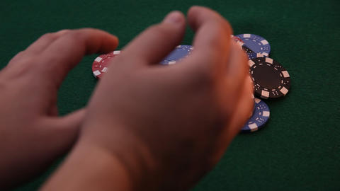 Hands pushing poker chips away Live Action