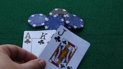 Straight Flush and grabbing poker chips Footage