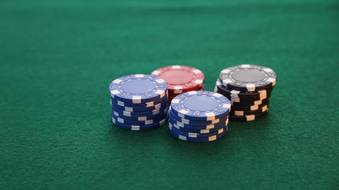 Ace and King placed on poker chips while king slides Stock Video Footage