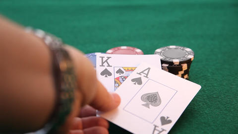 Ace and King placed on poker chips while king slides Footage