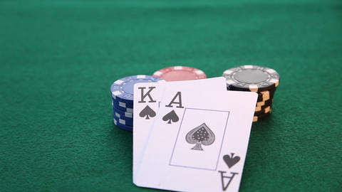 Ace and King placed on pile of poker chips Live Action