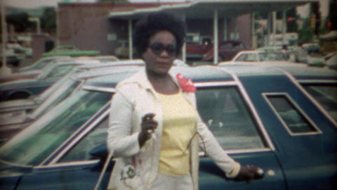 1969: Afro hairstyle African women at car in bank parking lot Footage