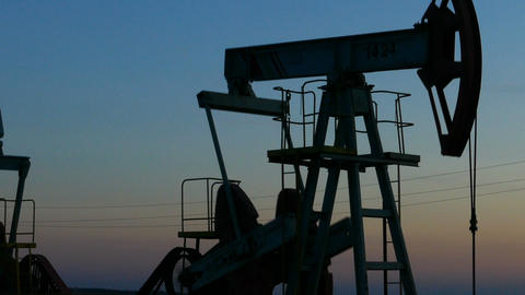 working oil pumps silhouette in dusk, zoom in Footage