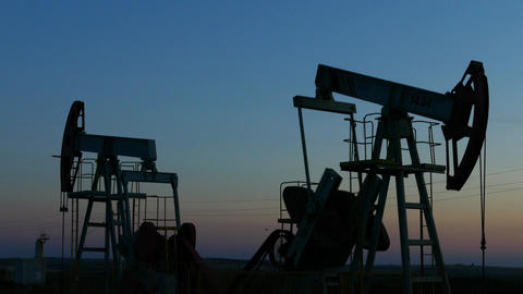 working oil pumps silhouette in dusk, 4k Footage