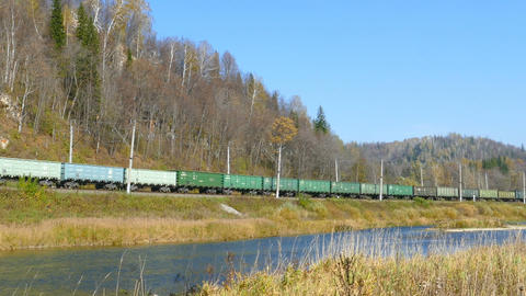 freight train rides along the river Footage