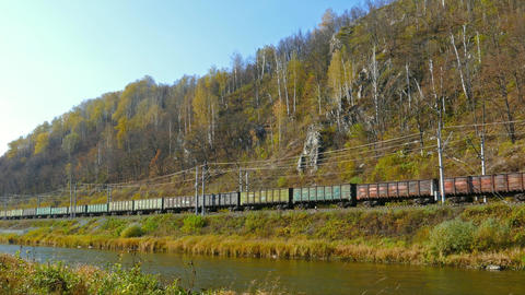 freight train rides along the river, 4k Footage
