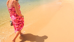 Girl in Red Long Dress Walks Barefoot along Water on Sand Beach Footage