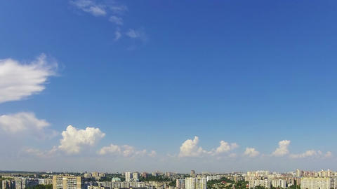 Clouds in the Blue Sky over City. Time Lapse Footage