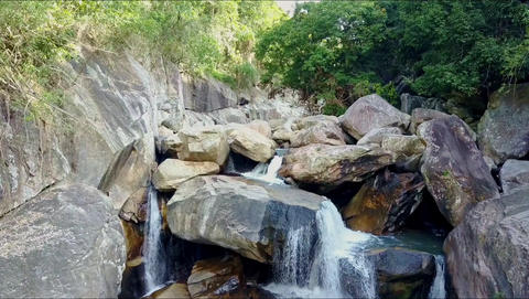 Close Aerial View River Waterfalls among Stones in Canyon Footage
