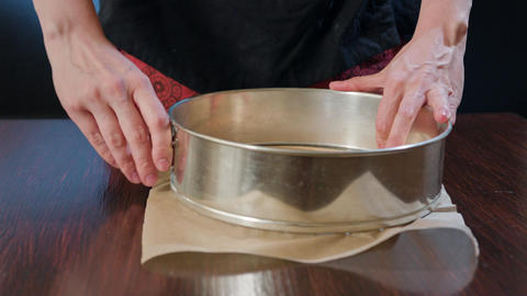 Cook Preparing a Baking Pan and Baking Paper Footage
