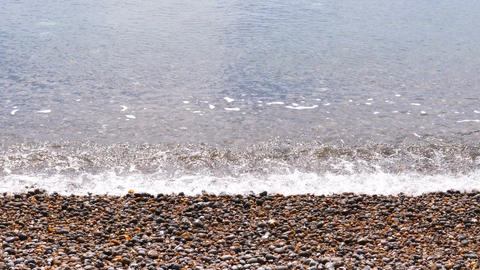 Pebbles beach and sea wave in slow motion Footage