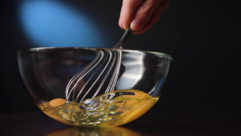 Stirring Eggs in a Glass Bowl with a Whisker Footage