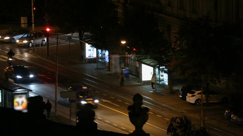Night city traffic in Zagreb city, view on bus stop and moving cars, cityscape Footage