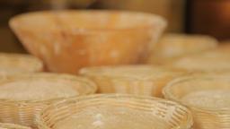 The baker sprinkle flour on dough Footage