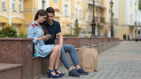 Young couple shopping online using mobile phone Footage