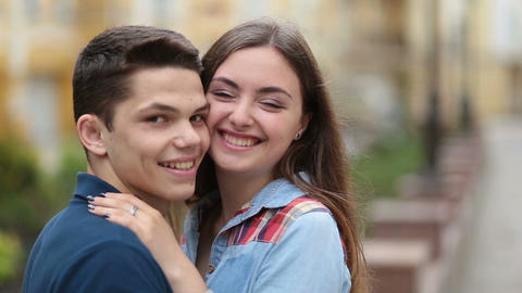Cheerful young couple in love smiling outdoors Footage