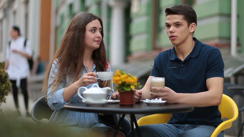 Dating couple relaxing together in street cafe Footage