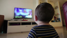 baby watching blurred content on TV Footage