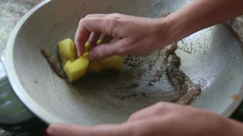 Woman Sponges down Frying Pan Footage