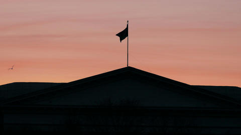 4K Abstract National Flag on Roof of Official Building Fluttering Against Footage