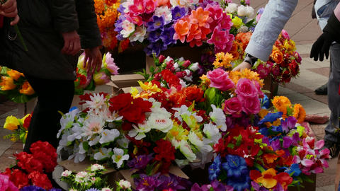 4K Ungraded: Woman Chooses Artificial Flowers at Outlet in Open Air Footage