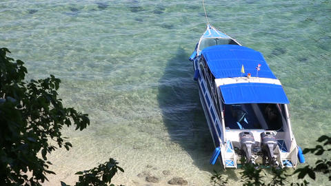 Motor Tourist Speed Boat Tied up at Sea Coast Footage