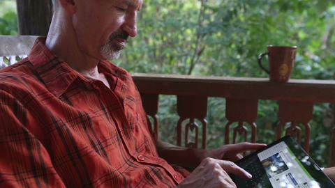 Old Man Wonders at News in Tablet PC Live Action