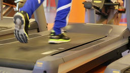 Close up of legs running on a treadmill in a gym Footage