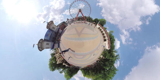 tiny planet child play in fountain Footage