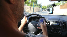 Driver texting while driving Stock Video Footage