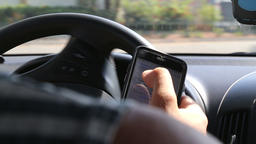 Driving and using mobile phone Footage