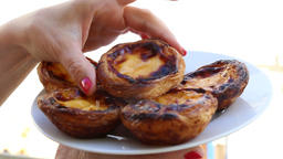 Eating pastry from pastry shop of Belem in Lisbon Footage