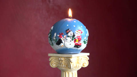 Rotating on column New Year Christmas decorative candle Footage
