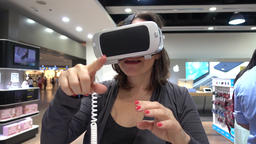 Funny woman putting on VR headset.mp Footage