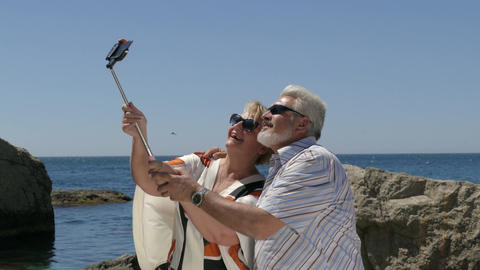 Mature Couple Taking Selfie On Smartphone At Beach Resort First Time Footage