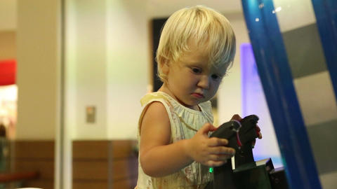 Child Holding Joystick and Playing on the Machine Footage