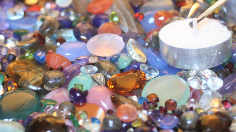 Set up candle fire in precious gemstones pile smooth zoom Filmmaterial