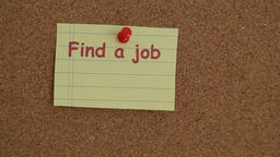Job searching reminder note attached to a bulletin board made of cork Footage