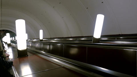 Escalator in the subway moving down. Moscow metro station Aviamotornaya GIF
