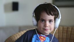 little boy with earphones Footage