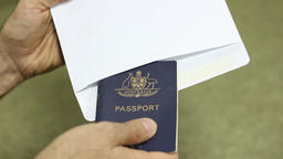 inserting passport to a white envelope Footage